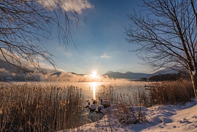 Winterlicher Tegernsee Sonnenuntergang Relais Chalet Wilhelmy