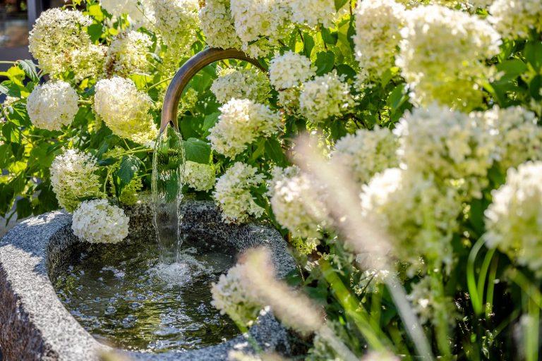 Gartenbrunnen mit Wasser Relais Chalet Wilhelmy